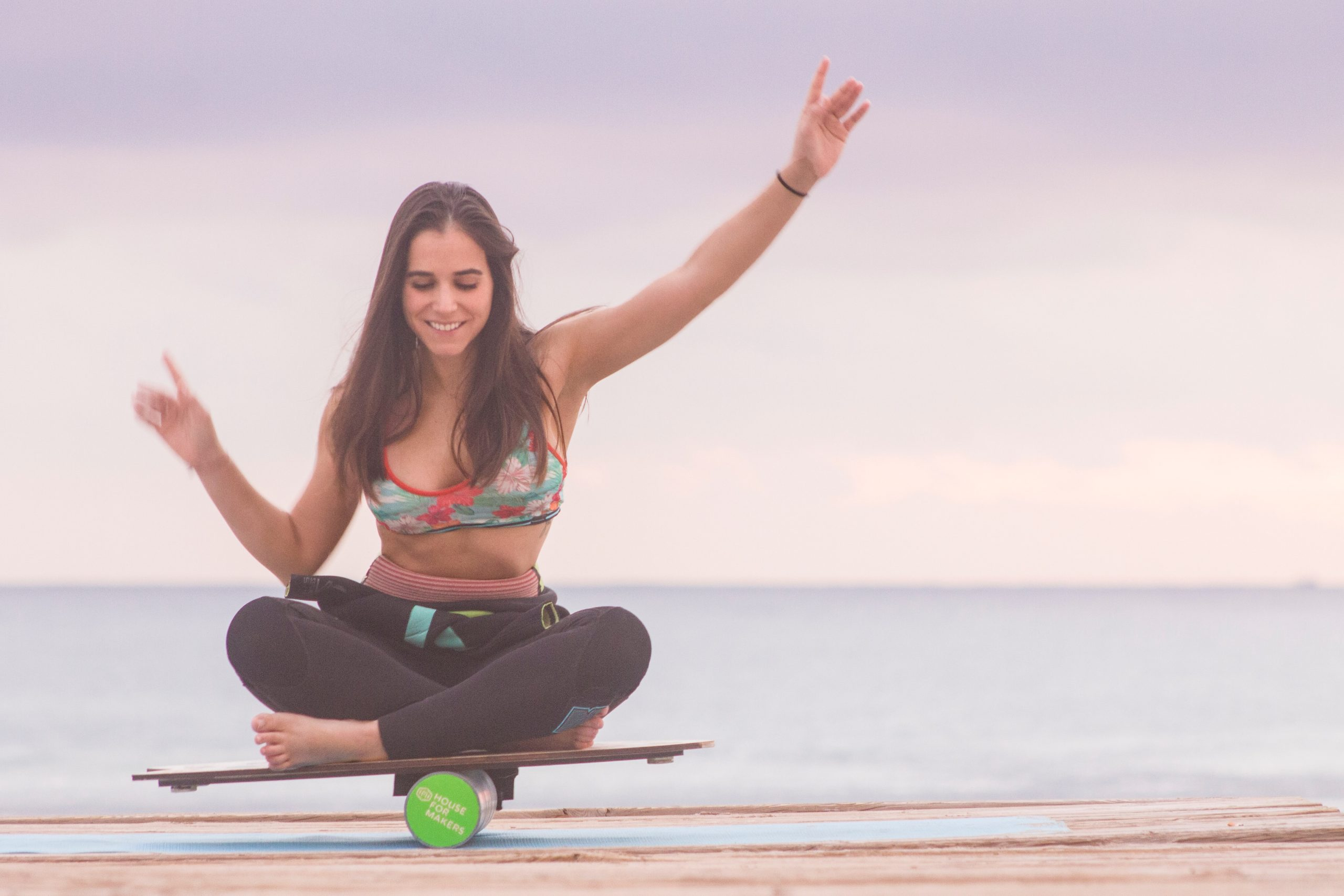 Balance training at sunrise on the beach before surf session