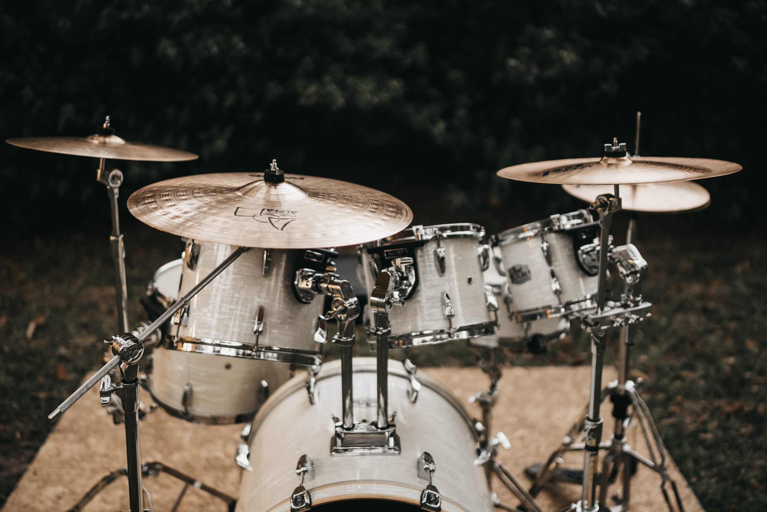 close-up of white and gray drum set