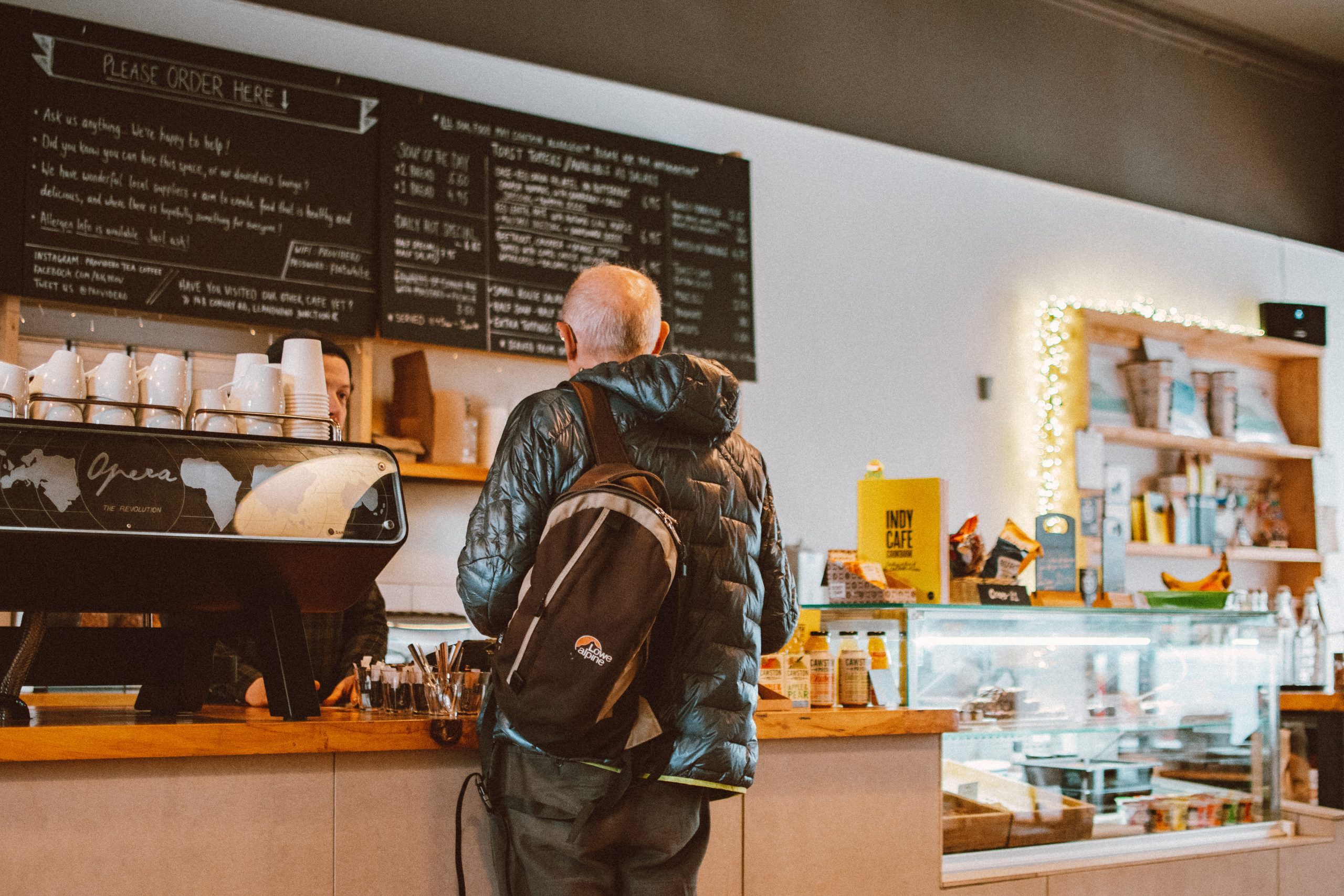Man standing in front of counter