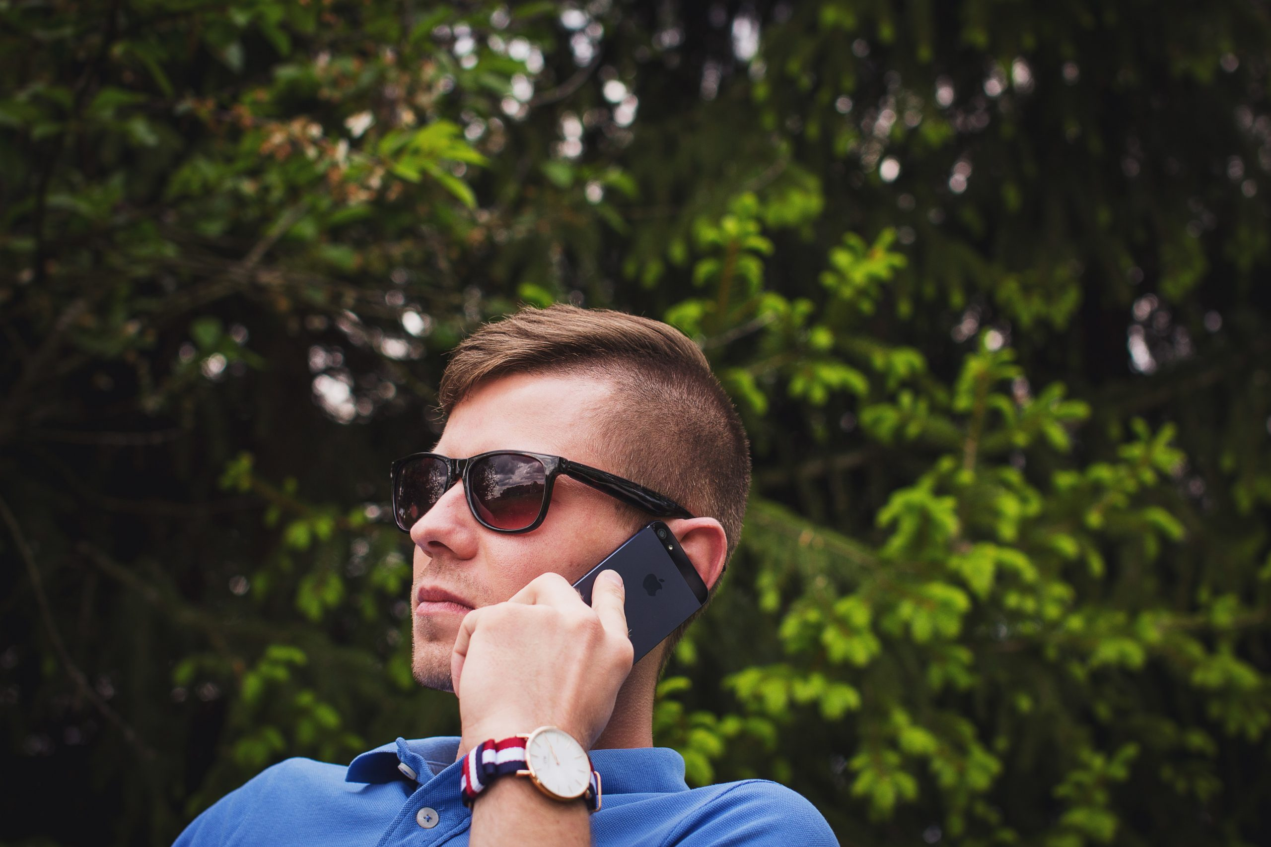 person holding Android smartphone wearing black sunglasses