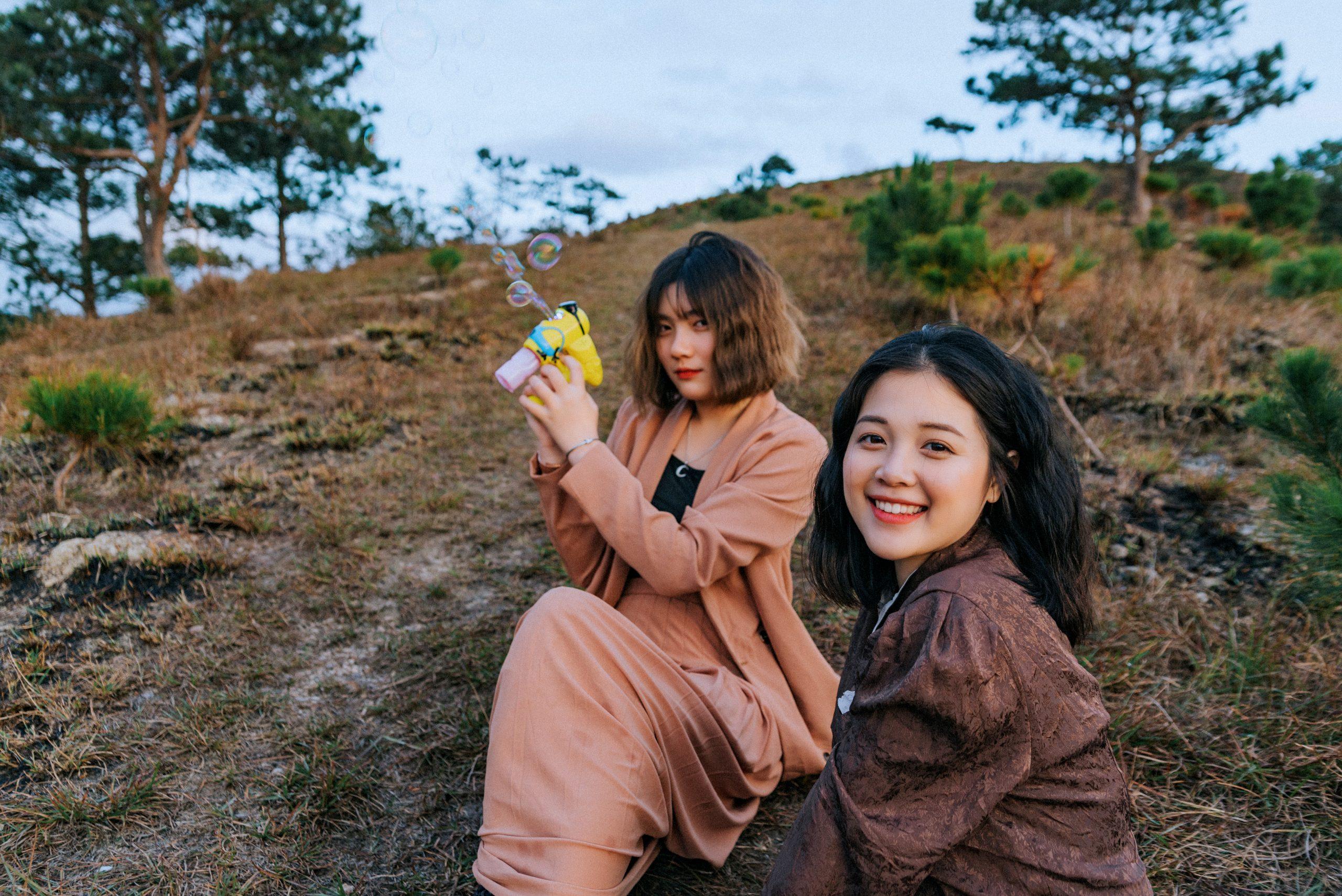 Photo of women sitting on grass