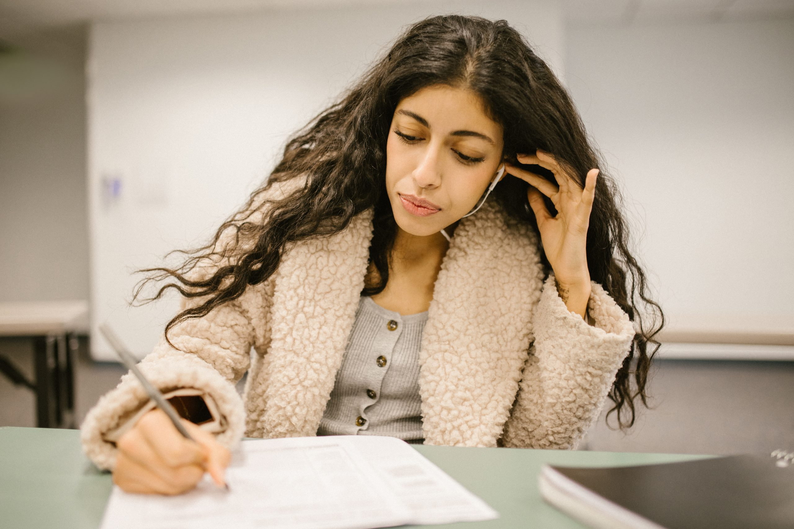 Student cheating during an exam by using an earphone