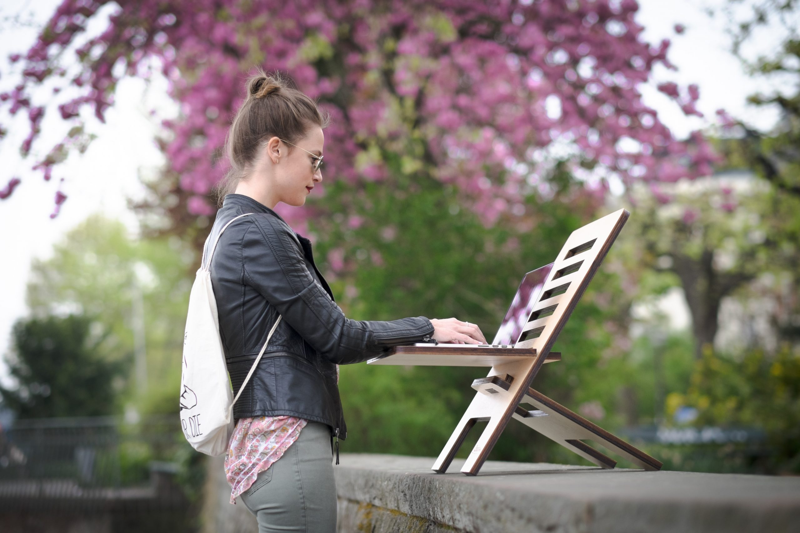 woman working outdoors on a standing desk